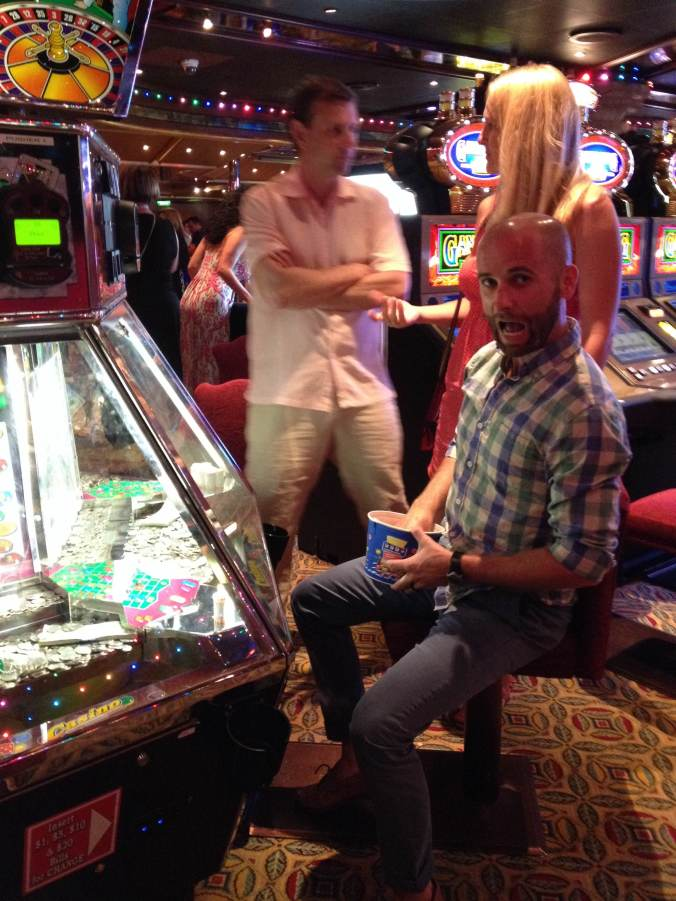 Benson picked up a handy gambling habit on the cruise. Note Jason and Heather in the background. (He'd just called her a milkmaid.)