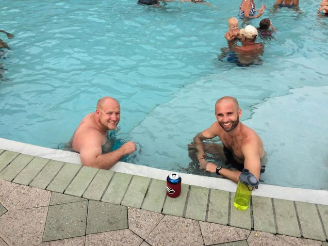 Benson and Heath, the guy who'd helped us, in the pool the next day, reminiscing about our crazy night.